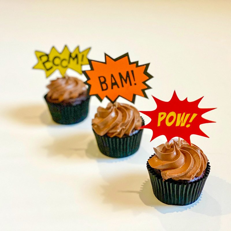 Boom Bam and Pow cupcake toppers on chocolate cupcakes for a superhero party