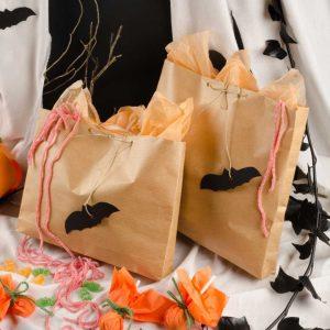 halloween treats in paper bag with bat label