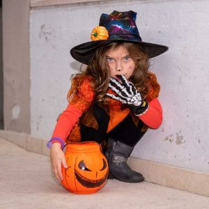 little girl in halloween costume with gloves covid halloween ideas