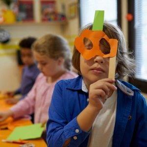 boy with halloween DIY costume mask