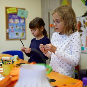 kids making halloween decorations